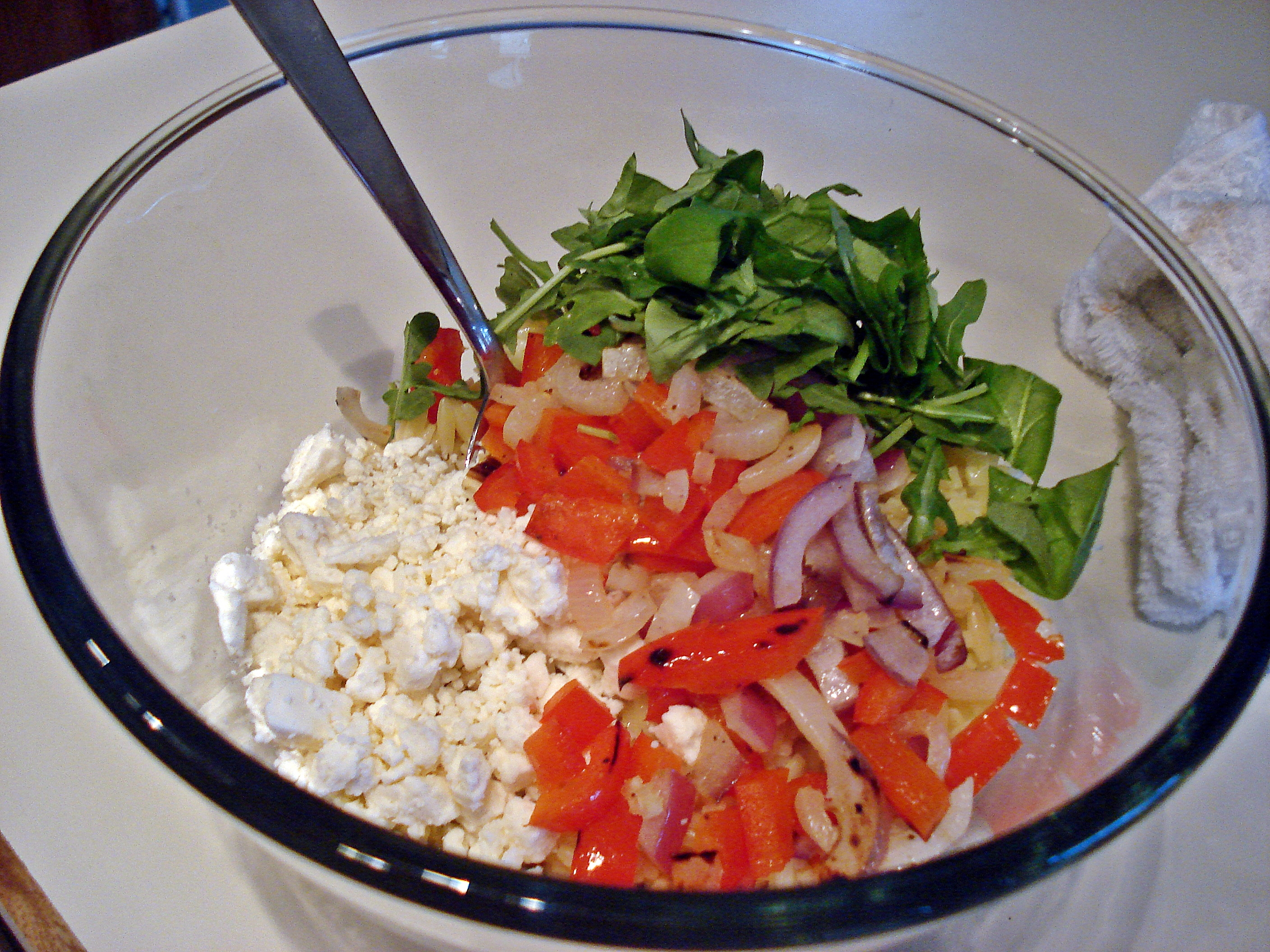 grilled red onions & red peppers, feta cheese, basil, and arugula
